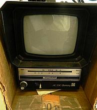 A vintage National TV in box