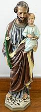 A statue of Joseph with child