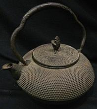 A Metal Asian Teapot
