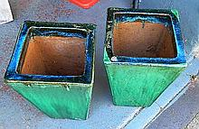 A pair of square-tapered glazed terracotta planter pots