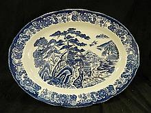 An Asian Style Blue and White Serving Dish Depicting Mountain Scene