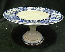 A Blue and White Crackle Glaze Comport Depicting Asian Ceremonial Scenes