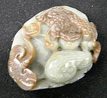 A Jade Charm with a Carving of a Dragon