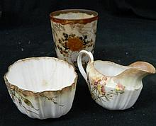 A Doulton Creamer and Sugar Bowl together with an Asian Style Cup