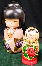 A Baboushka Doll together with A Japanese Wooden Geisha Doll