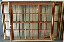 A cedar window set comprising two sliding panels and a fixed panel with a fixed cedar window frame