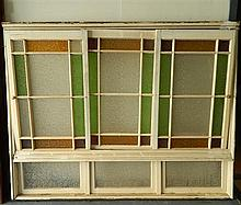A large Federation three panel coloured glass window, two sliding panels around one fixed