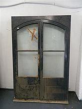 An arched double glazed door jamb and doors