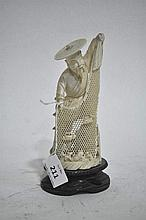 A carved ivory figure of a fisherman, 16cm H (excluding timber plinth)