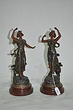 A pair of French spelter figure ornaments, Rayon de Soleil, 35cm H
