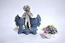 A Continental bisque figural vase, together with a Coalport floral ornament