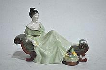A Royal Doulton figure ornament, At Ease, 21cm L