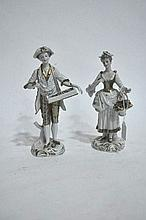 A pair of Continental porcelain figure ornaments, The Flower Sellers, 22cm H