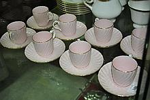A set of eight Mintons tea cups and saucers
