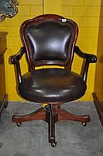 A mahogany framed office chair, red leather upholstered seat and back, swivel base