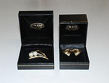 A pair of 18ct gold earrings, together with a pearl brooch, 14ct gold, each in G.W. Cox boxes