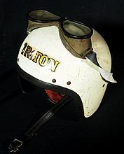 A vintage crash helmet and goggles