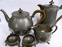 An English pewter teapot, coffee pot and cream jug together with two pewter salts.