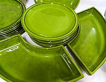 Fourteen Italian Green glazed terracotta Plates With Four Serving Dishes and One matching Matching Salad Bowl