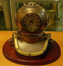 A desk clock in the form of a diving helmet