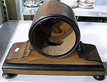 A Victorian walnut and black cased clock.