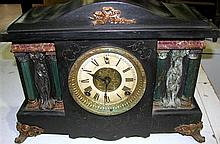 A late Victorian black painted mantle clock.