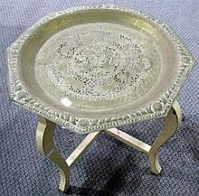 An Indian brass tray on white painted base.