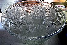 A pressed glass punch bowl and glasses and ladle.