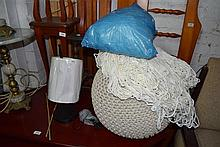 A knitted ottoman table lamp and a quantity of netting