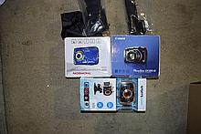 A Canon and Thomson digital cameras with other accessories