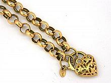 A Yellow Gold Necklace With Heart Shaped Latch