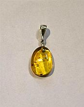A Sterling Silver Baltic Amber Pendant with insect