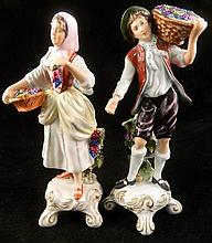 A pair of Royal Dux figures of grape pickers