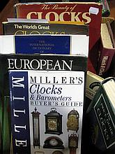 A collection of books, clocks and watches