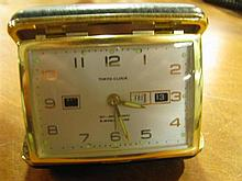 A 'Tokyo' travelling clock with day and date month