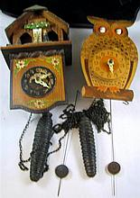 Two Black Forest clocks
