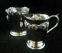 A silverplated ice bucket and matching water jug