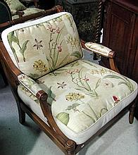 A pair of antique style arm chairs