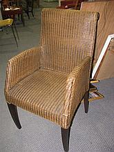 A set of eight wicker armchairs