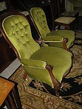 A Victorian walnut grandfather and grandmother chair