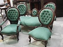 A three piece Victorian cameo back parlour suite