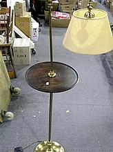 A brass standard lamp with table