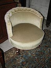 A Victorian nursing chair with green velvet upholstery
