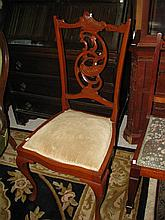 An Edwardian side chair with velvet upholstery