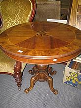 An antique style inlaid circular centre table