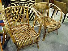A pair of vintage cane armchairs