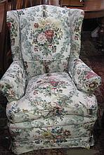 A wing arm chair with floral upholstery