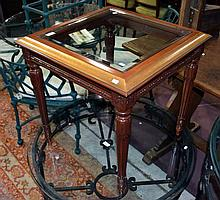 A timber side table with glass top
