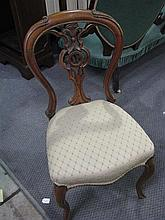A Victorian dining chair with carved back