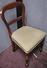 A Victorian style balloon back chair